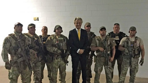 2015-05-03 19:13:23 A picture courtesy of Dutch Member of Parliament Geert Wilders shows members of a US SWAT team posing for a photo with Geert Wilders (C) prior to the  Two dead, one wounded at US Mohammed Art Exhibit on May 3, 2015 at the Curtis Culwell Center in Garland, Texas. The photo was taken by a local police officer with the mobile phone of the politician who released it via Twitter. Two suspects who may have been carrying bombs were shot dead May 3, 2015 and a police officer was wounded outside the Prophet Mohammed cartoon contest in Texas.   AFP PHOTO / HAND OUT    == RESTRICTED TO EDITORIAL USE / MANDATORY CREDIT: