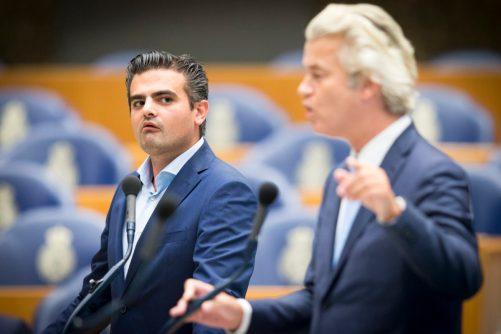 2016-09-13 16:55:30 DEN HAAG - Fractievoorzitter van Denk Tunahan Kuzu en PVV leider Geert Wilders tijdens het plenair debat in de Tweede Kamer over de nasleep van de legercoup in Turkije. ANP JERRY LAMPEN